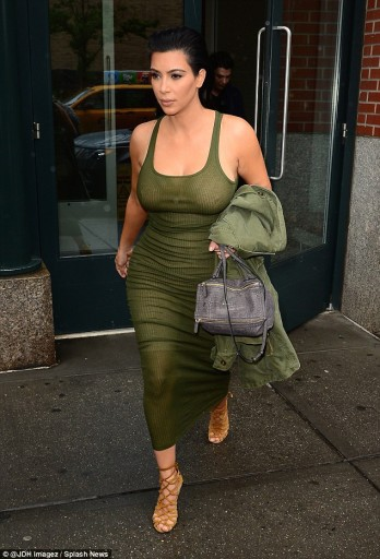 A pregnant Kim Kardashian wears a skintight dress while out and about in New York City on June 2, 2015