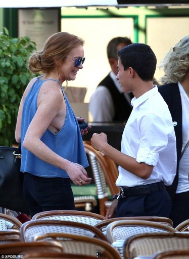 Lindsay Lohan turns heads as she goes braless in a denim top and striped platform sandals while in Monaco on June 18, 2015