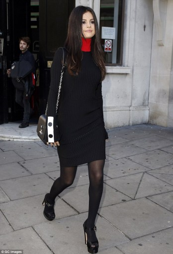 Selena leaves the Kiss FM Studios in a black high-neck dress