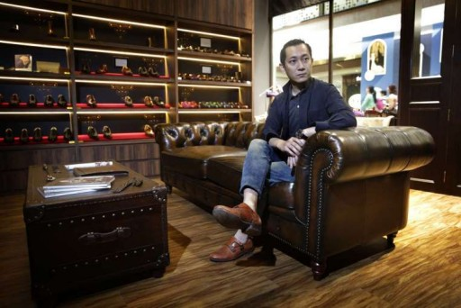 "Mr Edwin Neo's shop ed et al opened in MilleniaWalk about two years ago. It is decorated with a seasoned Chesterfield sofa and leather coffee table to look like a ""gentleman's living room"". ST PHOTO: KEVIN LIM"